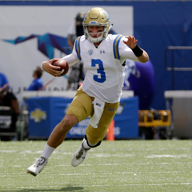 FILE - In this Sept. 16, 2017, file photo, UCLA quarterback Josh Rosen scrambles against Memphis in the second half of an NCAA college football game in Memphis, Tenn. Rosen is expected to be a first round pick in the NFL Draft. (AP Photo/Mark Humphrey, File)