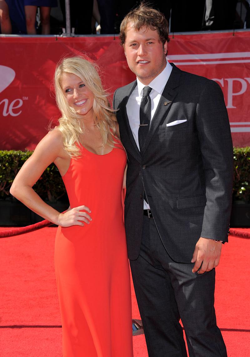 Detroit Lions quarterback Matt Stafford, right, and Kelly Hall arrive at the ESPY Awards on Wednesday, July 11, 2012, in Los Angeles. (Photo by Chris Pizzello/Invision/AP)