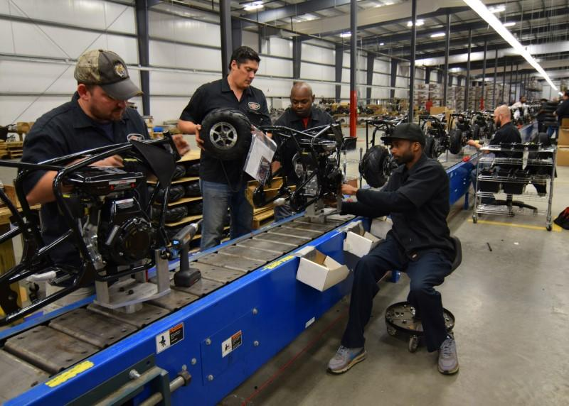 Workers construct mini-bikes at motorcycle and go-kart maker Monster Moto in Ruston, Louisiana January 25, 2017. Picture taken January 25, 2017. REUTERS/Nick Carey