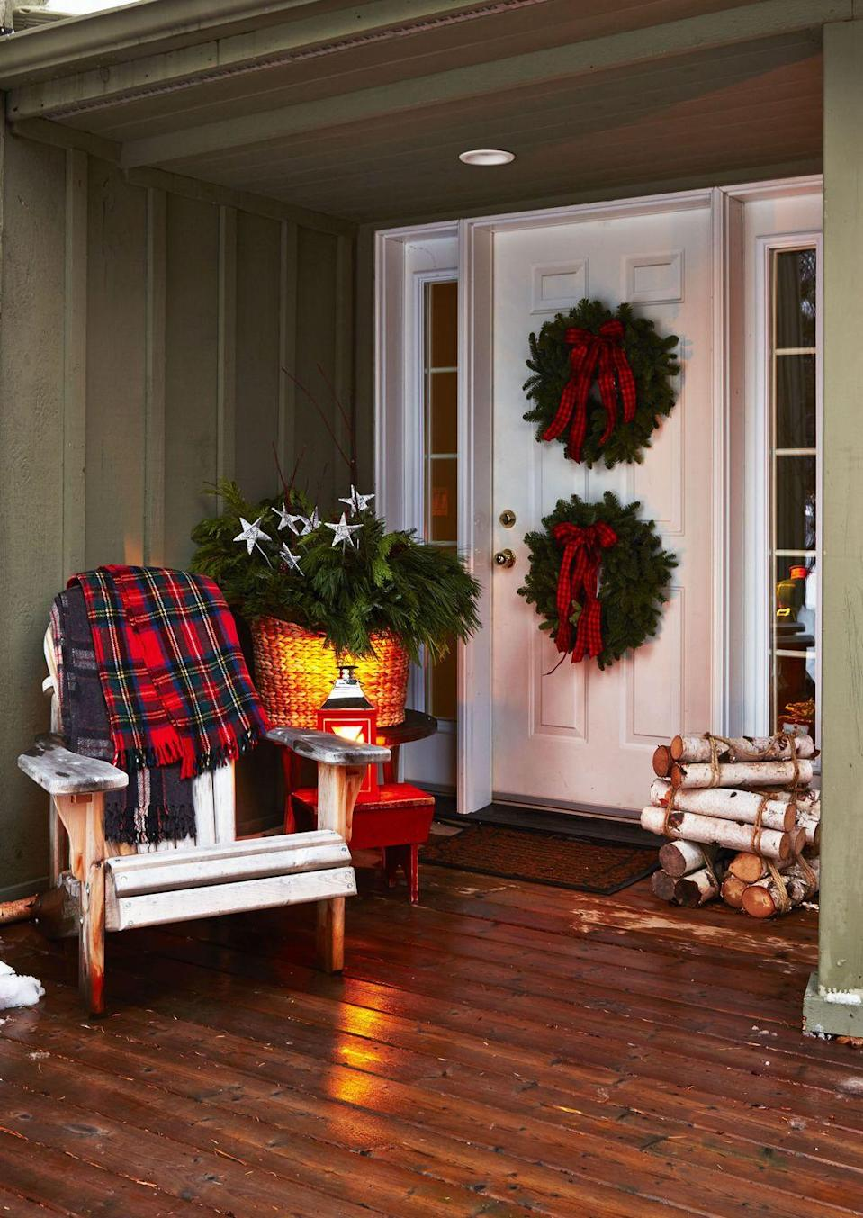 "<p>Two wreaths > one. Stacked on a front door, your entryway will look twice as merry. </p><p>See more at <a href=""http://www.goodhousekeeping.com/holidays/christmas-ideas/how-to/g2203/christmas-decoration-ideas/"" rel=""nofollow noopener"" target=""_blank"" data-ylk=""slk:Good Housekeeping"" class=""link rapid-noclick-resp"">Good Housekeeping</a>. </p>"