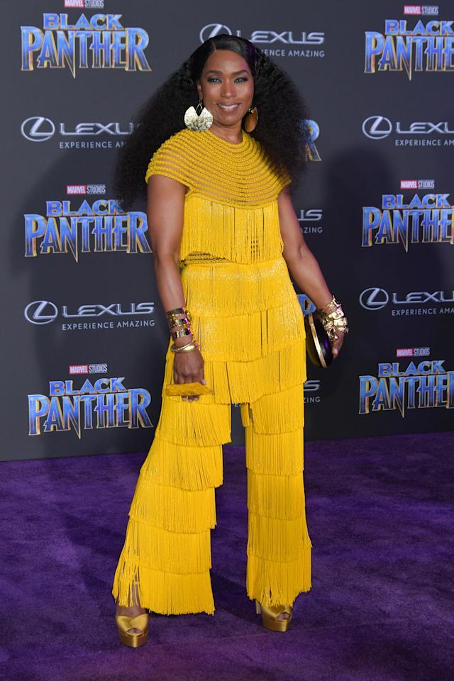 <p>The 59-year-old actress teams a fringed, Naeem Khan ensemble with statement earrings. <em>[Photo: Getty]</em> </p>