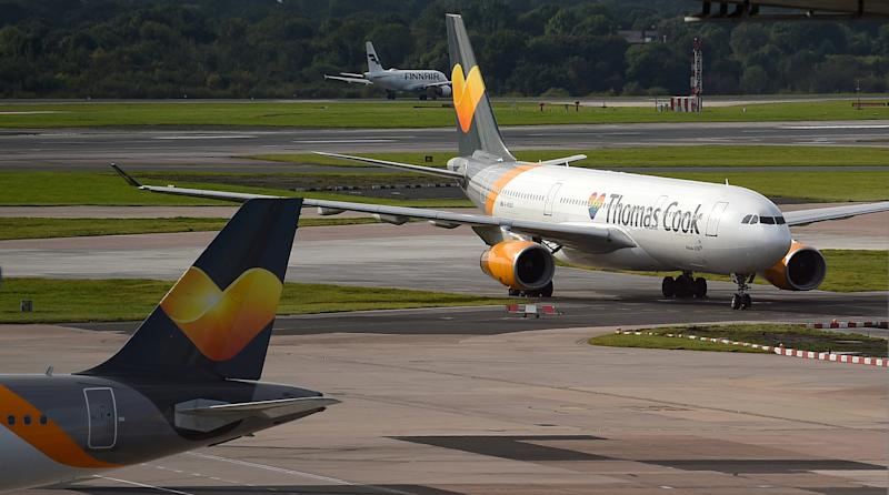 A Thomas Cook passenger aircraft taxis after landing at Manchester Airport on Monday