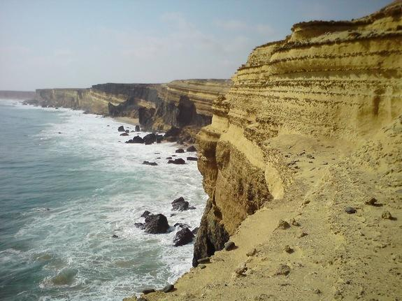 2) Stunning sea cliffs on the coast of Angola were fossil beds reveal a rich Cretaceous ecosystem