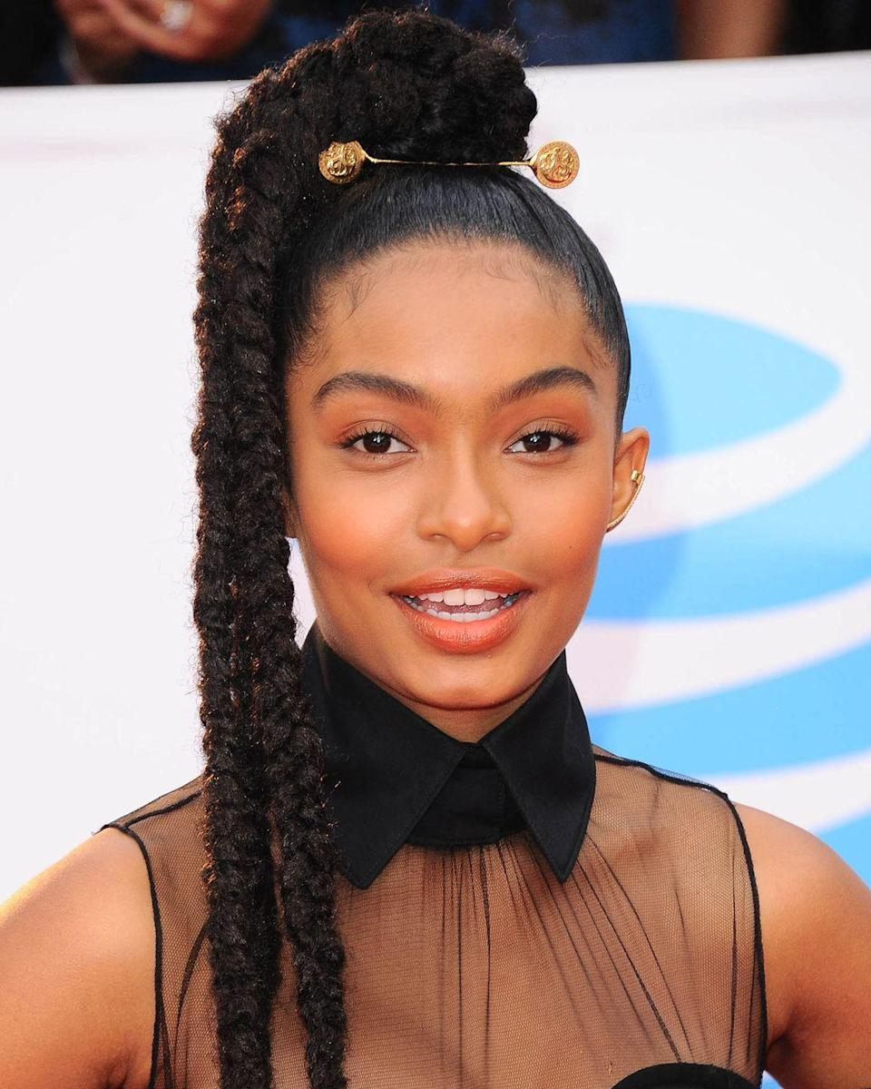 <p>Turn your braids into a power ponytail a la Yara Shahidi by making them extra long and adding a gold clasp.</p>