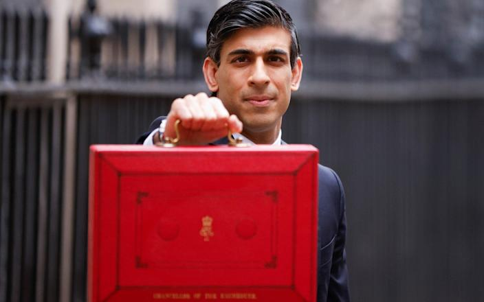 Britain's Chancellor of the Exchequer Sunak presents the budget box in London - JOHN SIBLEY/REUTERS