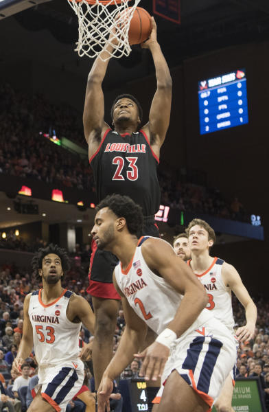 Louisville center Steven Enoch (23) goes up for a dunk against several Virginia defenders during the first half of an NCAA college basketball game in Charlottesville, Va., Saturday, March 7, 2020. (AP Photo/Lee Luther Jr.)