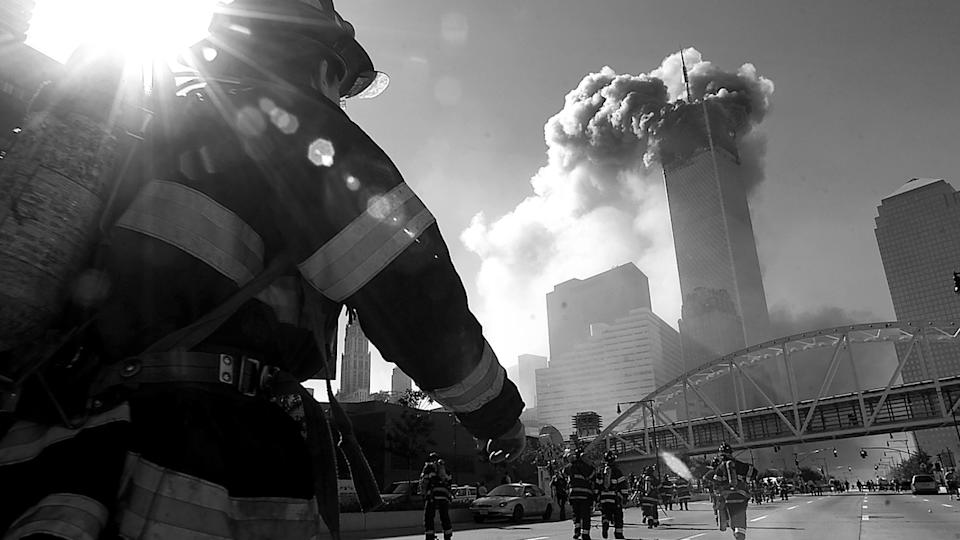 Firefighters walk toward one of the towers at the World Trade Center before it collapsed on Sept. 11, 2001, in New York City.