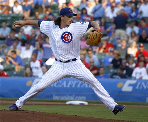 Chicago Cubs starting pitcher Jeff Samardzija delivers during the first inning of an interleague baseball game against the Los Angeles Angels on Wednesday, July 10, 2013, in Chicago. (AP Photo/Charles Rex Arbogast)
