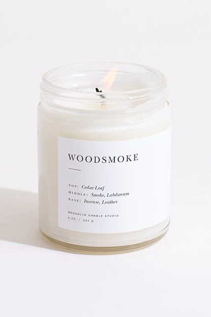 """<p>brooklyncandlestudio.com</p><p><strong>$28.00</strong></p><p><a href=""""https://go.redirectingat.com?id=74968X1596630&url=https%3A%2F%2Fbrooklyncandlestudio.com%2Fcollections%2Fcandles%2Fproducts%2Fwoodsmoke-minimalist-candle&sref=https%3A%2F%2Fwww.elle.com%2Fbeauty%2Fg34975490%2Fbest-candle-brands%2F"""" rel=""""nofollow noopener"""" target=""""_blank"""" data-ylk=""""slk:Shop Now"""" class=""""link rapid-noclick-resp"""">Shop Now</a></p><p>""""I've been a fan of Brooklyn Candle Studio for years. Sadly my favorite scent, Tobacco (which smells the way I imagine the man of my dreams smells), was recently discontinued. But they have a wide array of the warm, spicy and smoky scents that I love. They're richly scented but delicate enough not to aggravate my scent-triggered migraines (and I find the fellas like them, too). My favorites are Woodsmoke (for those of us with non-working fireplaces); Sunday Morning (the perfect foil for weekend mimosas); Hinoki (the one to take on your ski cabin getaway); Apple Cider (divine on a cold winter's day); Brooklyn (great for a craft cocktail loving person in your life).""""—<em>Laura Sampedro, deputy managing editor</em></p>"""