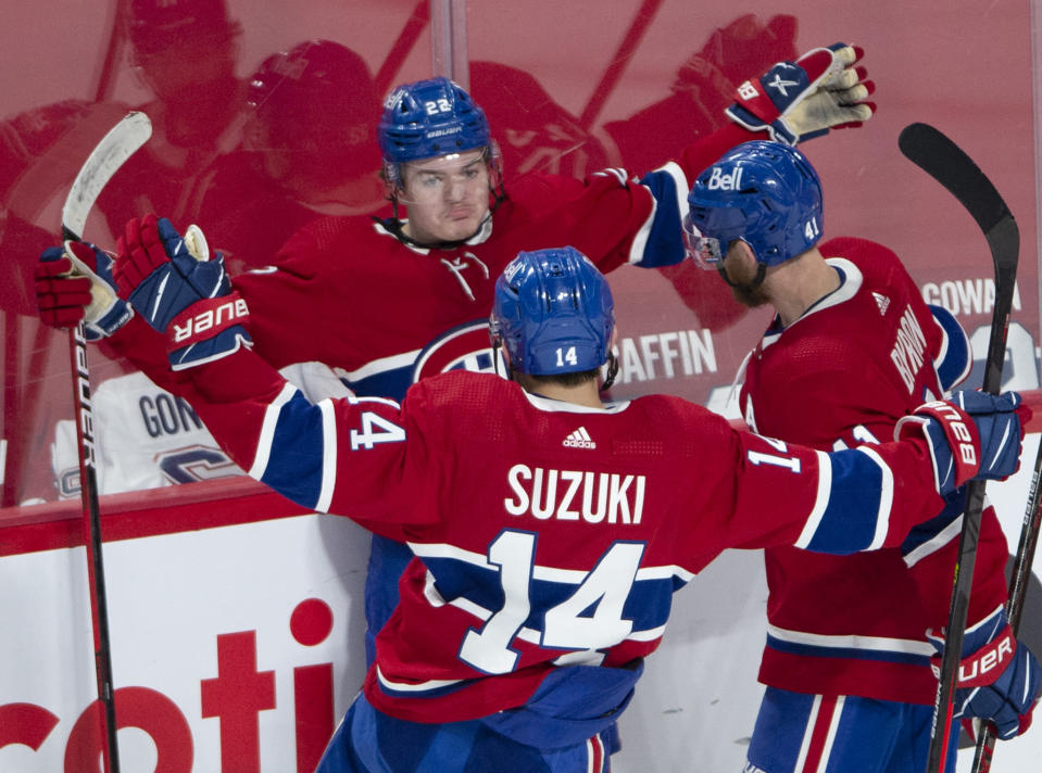 Montreal Canadiens right wing Cole Caufield (22) celebrates his goal against the Vegas Golden Knights with teammates Nick Suzuki (14) and Paul Byron (41) during the second period in Game 6 of an NHL hockey Stanley Cup semifinal playoff series Thursday, June 24, 2021 in Montreal. (Ryan Remiorz/The Canadian Press via AP)