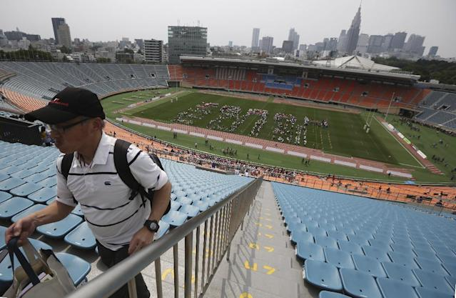"""The lines the volunteers form """"Japan 2019"""" to promote the 2019 Rugby World Cup hosted in Japan at the National Stadium in Tokyo, Sunday, May 25, 2014. The stadium, first built in 1964 to host Tokyo Olympics, will be rebuilt and replaced for the 2020 Summer Olympics and Paralympics to house 80,000 spectators. (AP Photo/Eugene Hoshiko)"""