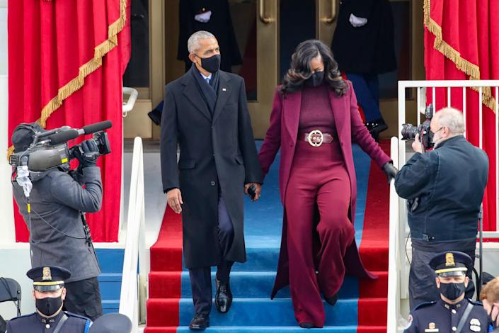 Former President Barack Obama and former First Lady Michelle Obama (in Sergio Hudson)
