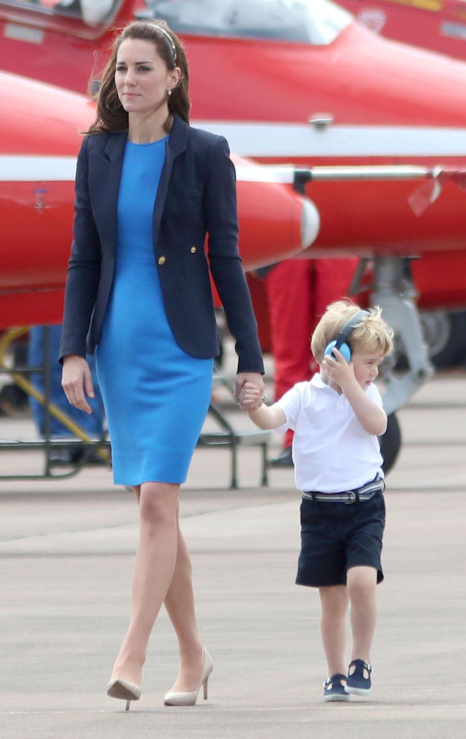 <p>Accompanied by William and Prince George, Kate's trip to RAF Fairford featured a fitted Stella McCartney dress and navy blazer along with her usual L.K. Bennett shoes.</p><p><i>[Photo: PA]</i></p>
