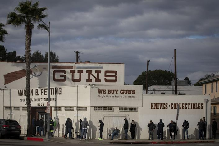 Customers line up outside a Culver City gun store in March