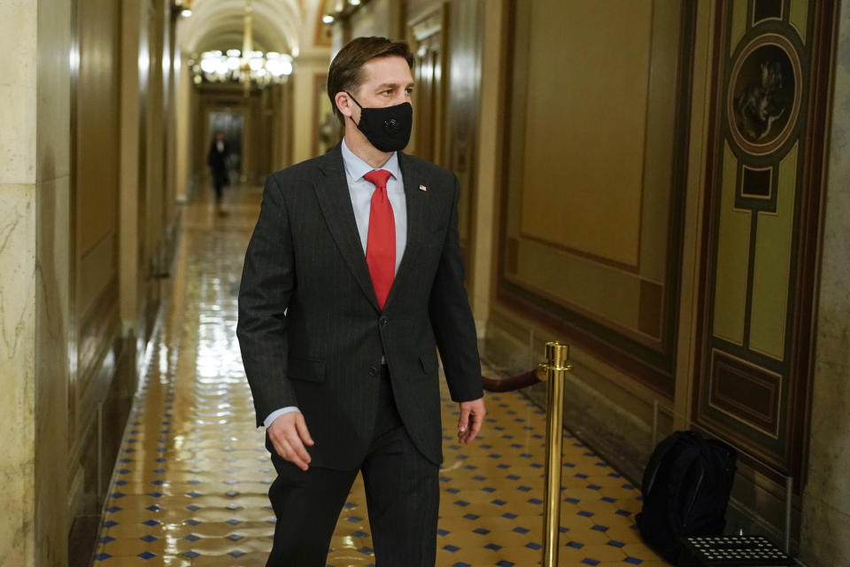 Sen. Ben Sasse, R-Neb., walks during a break in the second impeachment trial of former President Donald Trump, at the Capitol, Wednesday, Feb. 10, 2021 in Washington. (Joshua Roberts/Pool via AP)