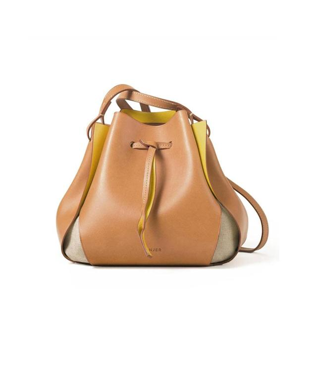 """<p>The Tulip Bag, $425,<a href=""""https://www.linjer.co/products/the-tulip-bag?variant=7125677703228"""" rel=""""nofollow noopener"""" target=""""_blank"""" data-ylk=""""slk:linjer.co"""" class=""""link rapid-noclick-resp""""> linjer.co</a> </p>"""