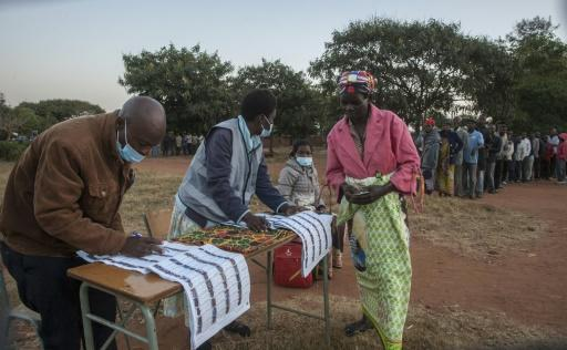 At Malembo Primary School in the capital, voters washed their hands with soap and water before lining up to vote, but none wore face masks or kept their distance in the long queue