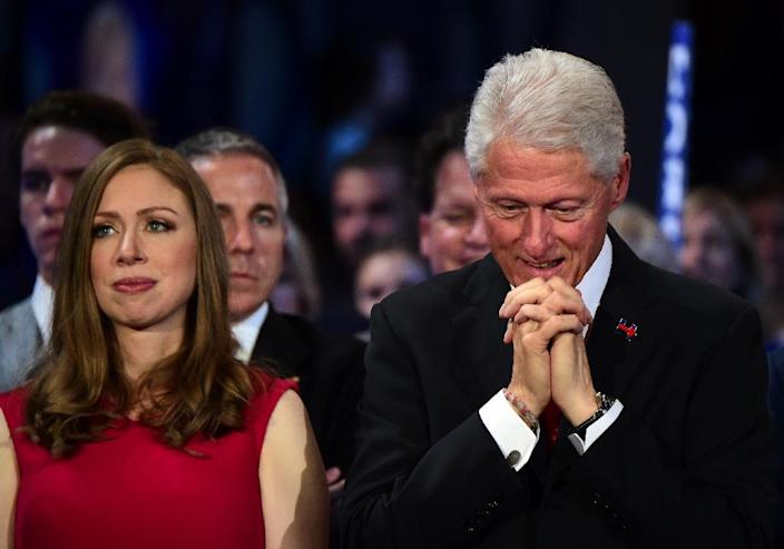 Bill Clinton and Chelsea Clinton, listen to Presedential Candidite Hillary Clinton speak on the last day of the Democratic National Convention at the Wells Fargo Center, July 28, 2016 in Philadelphia, Pennsylvania (AFP Photo/Robyn Beck)