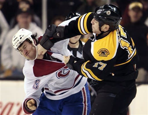 Montreal Canadiens right wing Brandon Prust (8) exchanges blows with Boston Bruins left wing Milan Lucic (17) in the second period of an NHL hockey game in Boston, Sunday, March 3, 2013. (AP Photo/Steven Senne)