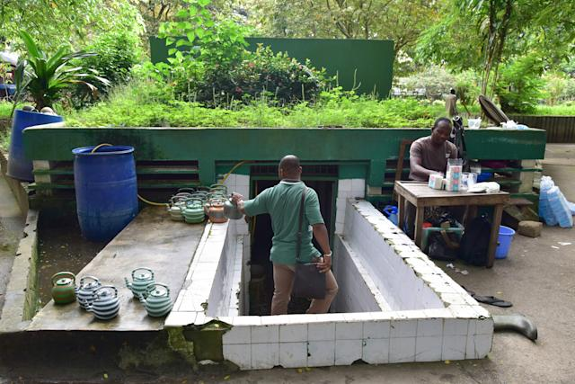 <p>Public toilets in Abidjan, Ivory Coast. (Photo: Issouf Sanogo/AFP/Getty Images) </p>