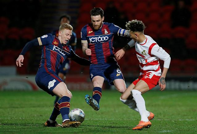 "Soccer Football - League One - Doncaster Rovers vs Bradford City - Keepmoat Stadium, Doncaster, Britain - March 19, 2018 Bradford City's Callum Guy and Romain Vincelot in action with Doncaster Rovers' Alex Kiwomya Action Images/Craig Brough EDITORIAL USE ONLY. No use with unauthorized audio, video, data, fixture lists, club/league logos or ""live"" services. Online in-match use limited to 75 images, no video emulation. No use in betting, games or single club/league/player publications. Please contact your account representative for further details."