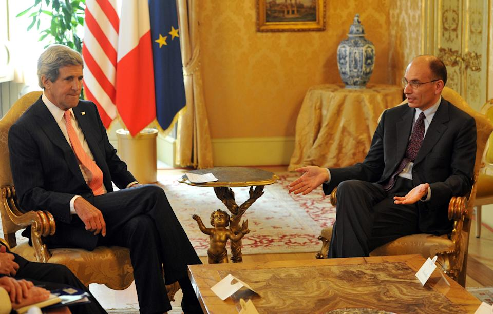 US Secretary of State John Kerry, left, listens to Italian Prime Minister Enrico Letta during their meeting at the Palazzo Chigi in Rome on Thursday May 9, 2013. (AP Photo/Mladen Antonov)