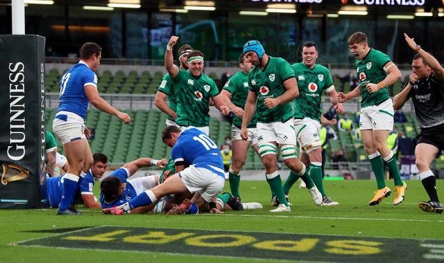 Ireland celebrate as CJ Stander, hidden, goes over for their first try