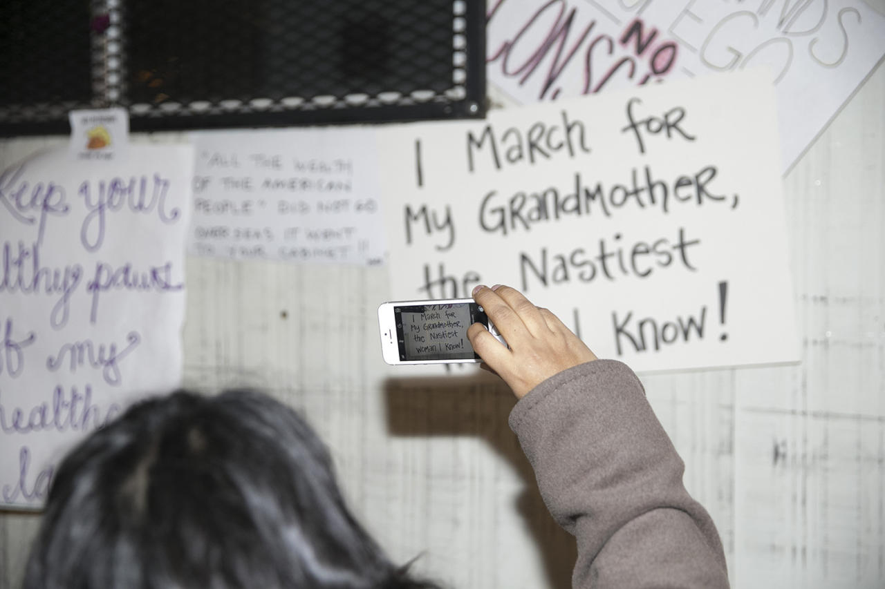 <p>A woman takes a photo of a discarded sign from Women's March in New York City on Jan. 21, 2017. (Photo: Gordon Donovan/Yahoo News) </p>