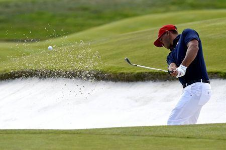 Sep 30, 2018; Paris, FRA; United States golfer Brook Koepka plays from a bunker on the 18th hole during the Ryder Cup Sunday singles matches at Le Golf National. Mandatory Credit: Ian Rutherford-USA TODAY Sports