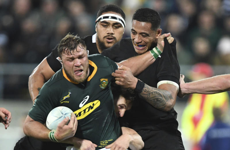 South Africa's Duane Vermeulen, left, is held in a tackle by New Zealand's Shannon Frizell during a Rugby Championship match between the All Blacks and South Africa in Wellington, New Zealand, Saturday, July 27, 2019. (AP Photo/Ross Setford)
