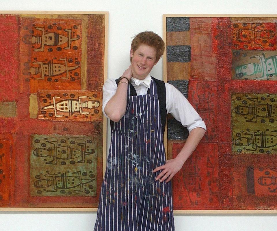 <p>The teenage prince shows off his artwork at Eton College.</p>