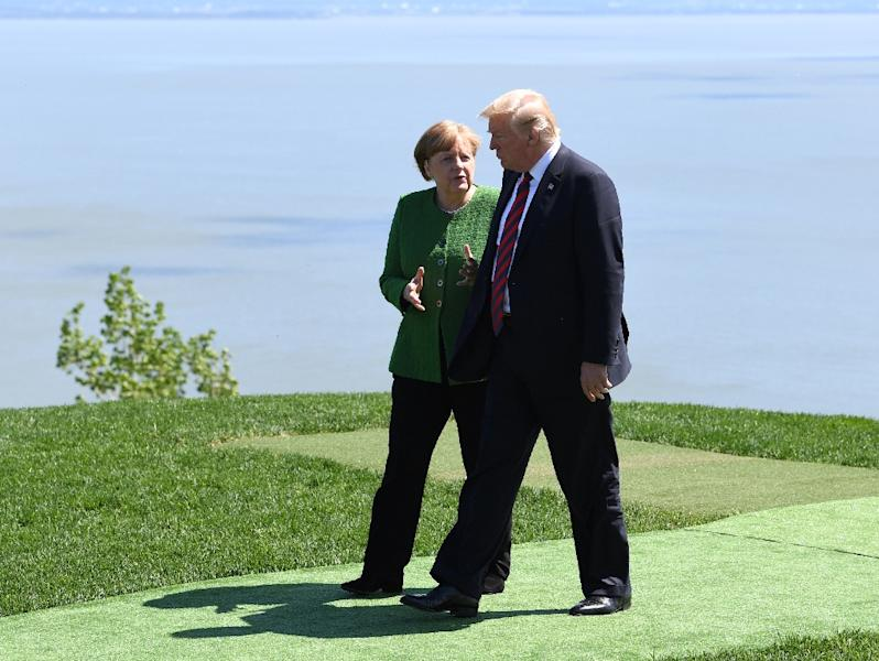 German Chancellor Angela Merkel (L) and US President Donald Trump (R), pictured at the June, 2018 G7 summit in Canada, before he claimed crime in Germany is way up, despite official data showing it is at its lowest since 1992 (AFP Photo/SAUL LOEB)
