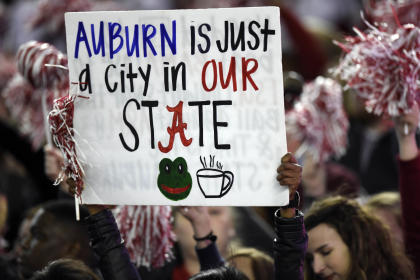 Alabama fans hold up a sign during the Crimson Tide's 2014 win over Auburn. (USAT)