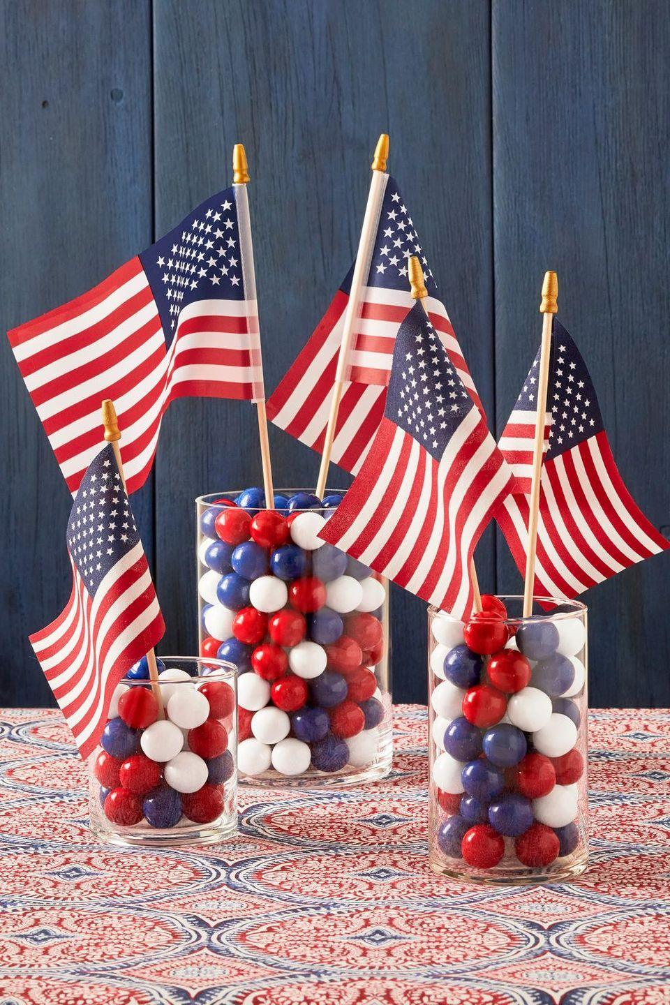 """<p>Is it any surprise that our favorite party ideas are the ones that are, well, edible? Take a cue from this 4th of July décor idea by placing colorful candies into glass holders, then stick flags or other decorations inside. (Pro tip: Make sure the candies you select don't easily melt.)</p><p><a class=""""link rapid-noclick-resp"""" href=""""https://go.redirectingat.com?id=74968X1596630&url=https%3A%2F%2Fwww.walmart.com%2Fsearch%2F%3Fquery%3Dsmall%2Bamerican%2Bflags&sref=https%3A%2F%2Fwww.thepioneerwoman.com%2Fjust-for-fun%2Fg36599700%2Fsummer-party-ideas%2F"""" rel=""""nofollow noopener"""" target=""""_blank"""" data-ylk=""""slk:SHOP AMERICAN FLAGS"""">SHOP AMERICAN FLAGS</a></p>"""
