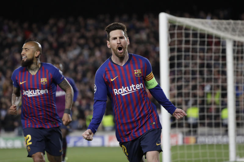 Barcelona's Lionel Messi right celebrates after scoring his side's third goal during the Champions League round of 16 2nd leg soccer match between FC Barcelona and Olympique Lyon at the Camp Nou stadium in Barcelona Spain Wednesday March