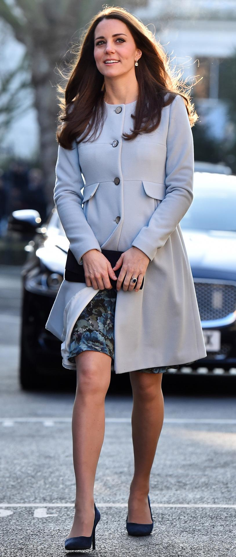 <p>For an engagement in Kensington, the Duchess wore a pale blue coat by her go-to maternity label, Seraphine, with a floral dress underneath. Suede Alexander McQueen shoes and a Stuart Weitzman bag completed the look. </p><p><i>[Photo: PA]</i></p>
