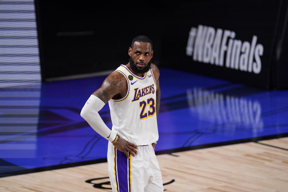 Los Angeles Lakers' LeBron James (23) looks on during the first half in Game 3 of basketball's NBA Finals against the Miami Heat, Sunday, Oct. 4, 2020, in Lake Buena Vista, Fla. (AP Photo/Mark J. Terrill)