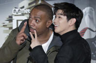 """FILE - In this Dec. 2, 2016 file photo, American musician Timothy Zachery """"Tim"""" Mosley, known professionally as Timbaland, left, and South Korean-American singer-songwriter Eric Nam, pose for photographers on the red carpet of the 2016 Mnet Asian Music Awards (MAMA) in Hong Kong. Korean American K-pop singers, including Nam, are sharing their experiences with stress in a series of podcasts addressing mental health issues to raise awareness beyond the K-pop community. (AP Photo/Kin Cheung, File)"""