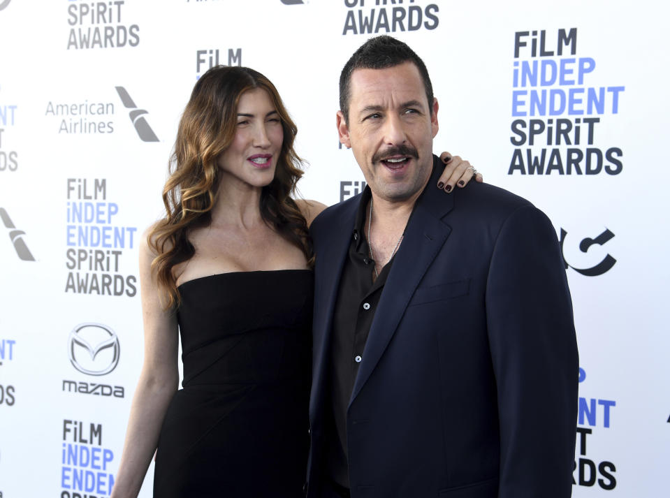 Jackie Sandler, left, and Adam Sandler arrive at the 35th Film Independent Spirit Awards on Saturday, Feb. 8, 2020, in Santa Monica, Calif. (Photo by Richard Shotwell/Invision/AP)
