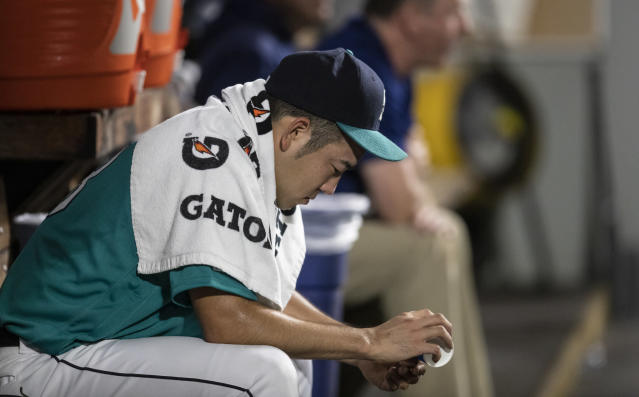 Seattle Mariners starting pitcher Yusei Kikuchi sits in the dugout after being pulled from the team's baseball game against the Chicago White Sox in the third inning Friday, Sept. 13, 2019, in Seattle. (AP Photo/Stephen Brashear)
