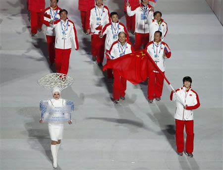 China's flag-bearer Tong Jian leads his country's contingent during the athletes' parade at the opening ceremony of the 2014 Sochi Winter Olympics, February 7, 2014. REUTERS/Lucy Nicholson