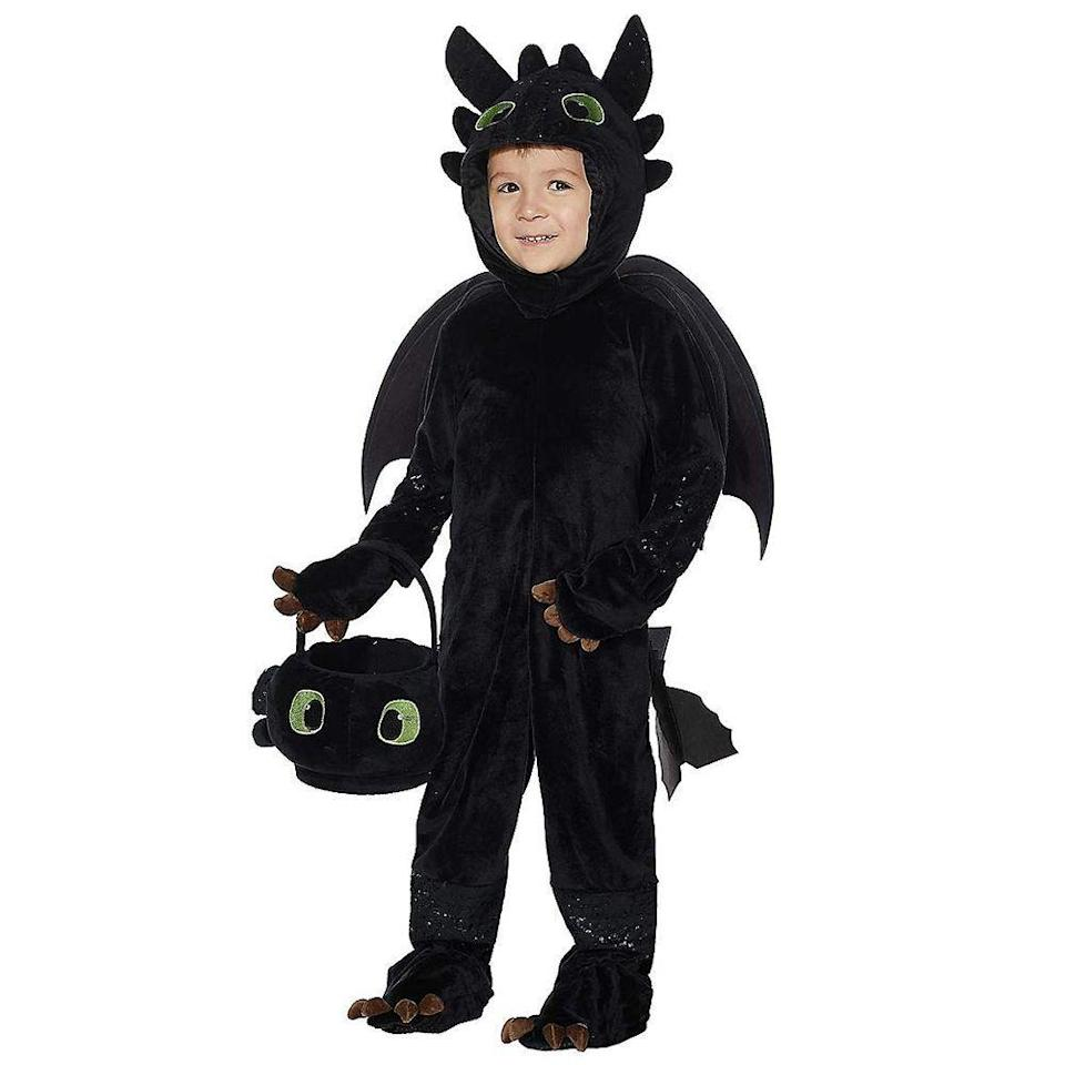 """<p><strong>Spirit of Halloween</strong></p><p>spirithalloween.com</p><p><strong>$39.99</strong></p><p><a href=""""https://go.redirectingat.com?id=74968X1596630&url=https%3A%2F%2Fwww.spirithalloween.com%2Fproduct%2Fhalloween-costumes%2Ftoddler-costumes%2Ftoddler-tv-movie-gaming-costumes%2Ftoddler-toothless-costume-how-to-train-your-dragon%2Fpc%2F4742%2Fc%2F798%2Fsc%2F3885%2F178114.uts&sref=https%3A%2F%2Fwww.bestproducts.com%2Flifestyle%2Fnews%2Fg2996%2Fcute-halloween-costumes-for-toddlers%2F"""" rel=""""nofollow noopener"""" target=""""_blank"""" data-ylk=""""slk:Shop Now"""" class=""""link rapid-noclick-resp"""">Shop Now</a></p><p>Transform your toddler into the beloved Toothless dragon with this adorable costume. Your kiddo will feel like they can actually take flight like their favorite character when they slip into this soft onesie. </p>"""