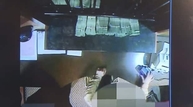 Surveillance footage of alleged money laundering was presented at a press conference marking the release of a 2018 report on money laundering. Attorney General David Eby said the tape shows wads of $20 bills being exchanged in a casino cash cage.