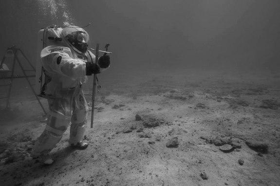 ESA astronaut instructor Hervé Stevenin ready to perform soil core sampling with a core tube and a hammer underwater off the coast of Marseille. During the mission, several soil samples were collected by the aquanauts with similar tools used o