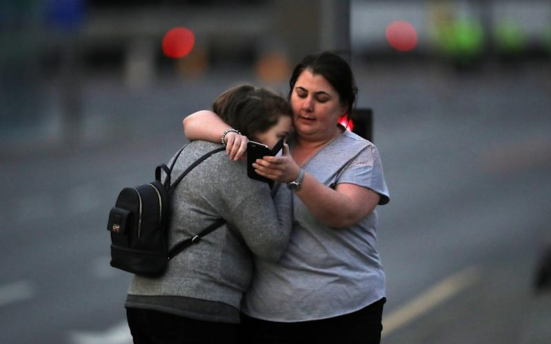 Ariana Grande concert attendees Vikki Baker and her daughter Charlotte, aged 13, leave the Park Inn where they were given refuge after last night's explosion at Manchester Arena - Credit: Getty