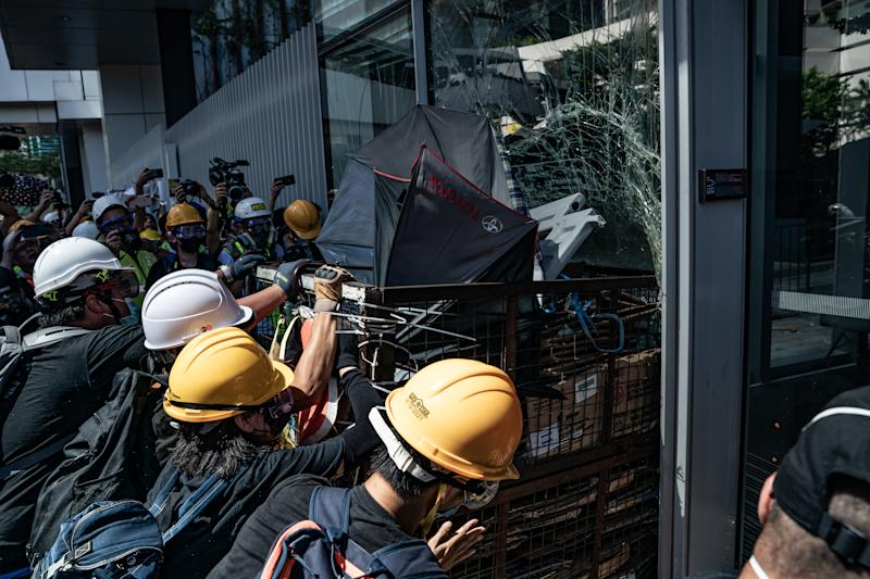 Protesters smash glass doors and windows of the Legislative Council Complex on July 1, 2019 in Hong Kong, China. (Photo: Anthony Kwan/Getty Images)