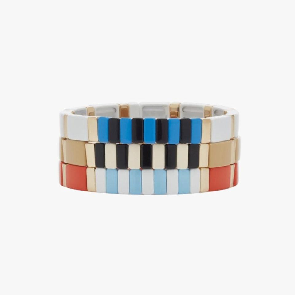 """Give your outfit the ideal finishing touch with Roxanne Assoulin's stacking bracelets. $225, MODA OPERANDI. <a href=""""https://www.modaoperandi.com/women/p/roxanne-assoulin/set-of-three-stadium-gold-tone-and-enamel-bracelets/395183"""" rel=""""nofollow noopener"""" target=""""_blank"""" data-ylk=""""slk:Get it now!"""" class=""""link rapid-noclick-resp"""">Get it now!</a>"""