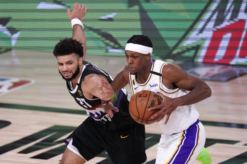 Denver Nuggets' Jamal Murray (27) has the ball stripped away by Los Angeles Lakers guard Rajon Rondo, right, during the second half of Game 3 of the NBA basketball Western Conference final Tuesday, Sept. 22, 2020, in Lake Buena Vista, Fla. (AP Photo/Mark J. Terrill)