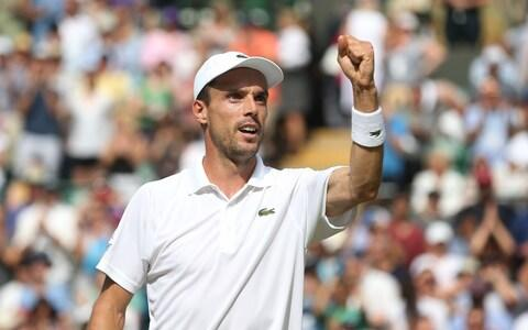 Bautista Agut celebrates after winning his match against Argentinian Guido Pella - Credit: Rob Newell /CameraSport