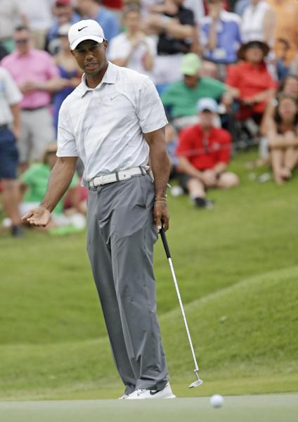 Tiger Woods gestures as his putt misses the cup in the ninth green during the third round of The Players championship golf tournament at TPC Sawgrass, Saturday, May 11, 2013 in Ponte Vedra Beach, Fla. (AP Photo/Gerald Herbert)